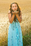 Beautiful woman enjoy in field of wheat Stock Photo