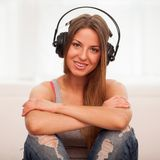Beautiful woman enjoy music in headphones Stock Images