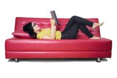 Beautiful woman enjoy reading a novel Royalty Free Stock Image