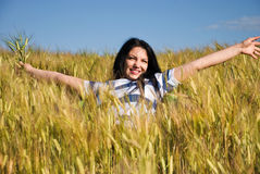 Beautiful woman enjoy summer in wheat field Royalty Free Stock Photos