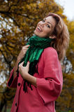 Beautiful woman enjoy walking in autumn Park Stock Images