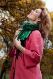 Beautiful woman enjoy walking in autumn Park Stock Images