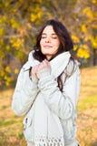 Beautiful woman enjoying in the autumn park Stock Photos