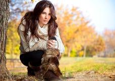 Beautiful woman enjoying in the autumn  park Royalty Free Stock Photo