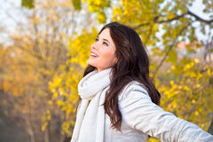 Beautiful woman enjoying in the autumn  park Stock Photo