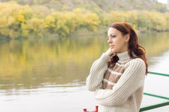 Beautiful woman enjoying autumn scenery Stock Image