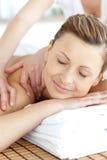 Beautiful woman enjoying a back massage Stock Images