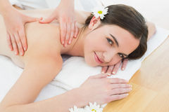 Beautiful woman enjoying back massage at beauty spa Royalty Free Stock Image