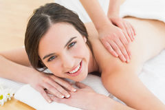 Beautiful woman enjoying back massage at beauty spa Stock Image
