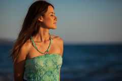 Beautiful woman enjoying the beach. Pretty Hispanic woman with eyes closed relaxing and the beach Royalty Free Stock Photos