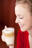 Beautiful woman enjoying caffee latte Stock Photography