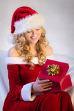 Beautiful woman enjoying christmas present Stock Photo