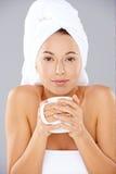 Beautiful woman enjoying coffee at a spa Stock Photography