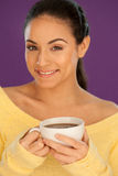 Beautiful woman enjoying a cup of coffee Stock Photography