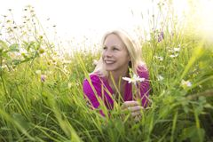 Beautiful woman enjoying daisy in a field Royalty Free Stock Images