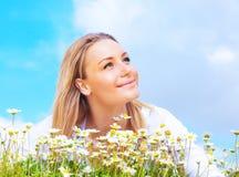 Happy girl enjoying daisy flower field stock photos