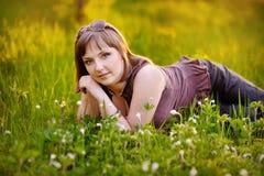 Beautiful woman enjoying daisy field Stock Image
