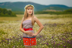 Beautiful woman enjoying daisy field, nice female lying down in meadow of flowers, pretty girl relaxing outdoor, having fun, holdi Stock Photography