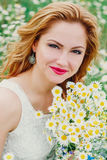 Beautiful woman enjoying daisy field in spring Stock Images