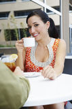 Beautiful Woman Enjoying a Date In a Cafe Stock Photos