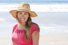 Beautiful Woman enjoying a day at the beach Stock Photos