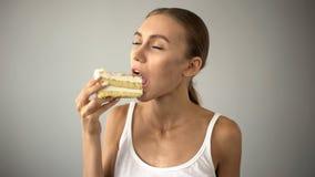 Beautiful woman enjoying delicious cake, sugar temptation, diabetes risk. Stock photo royalty free stock photos