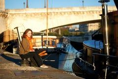 Beautiful woman enjoying early morning in Paris Royalty Free Stock Photography