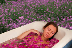 Beautiful woman enjoying floral bath Royalty Free Stock Image