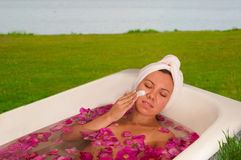 Beautiful woman enjoying floral bath Royalty Free Stock Images