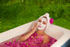 Beautiful woman enjoying floral bath Stock Photography