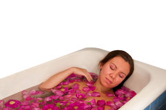 Beautiful woman enjoying floral bath Royalty Free Stock Photos