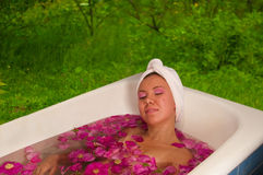 Beautiful woman enjoying floral bath Royalty Free Stock Photography