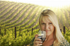 Beautiful Woman Enjoying a Glass of Wine at the Vineyard Royalty Free Stock Images