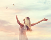 Beautiful woman enjoying her freedom. With arms open Stock Images