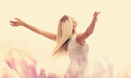 Beautiful woman enjoying her freedom. With arms open Stock Photography