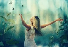 Beautiful woman standing with arms wide open Stock Photos