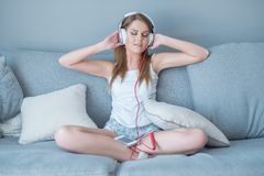 Beautiful woman enjoying her music library Stock Images