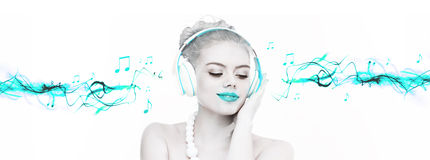 Beautiful woman enjoying her music Stock Image