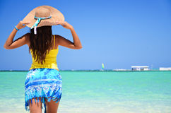 Beautiful woman enjoying her vacantion on the tropical beach Royalty Free Stock Photos