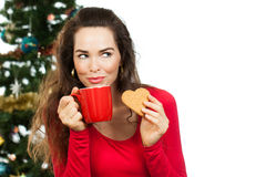 Beautiful woman enjoying hot drink and gingerbread Royalty Free Stock Image