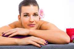 Beautiful woman enjoying a hot stone massage Royalty Free Stock Photos