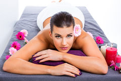 Beautiful woman enjoying a hot stone massage Stock Photo