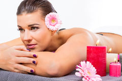 Beautiful woman enjoying a hot stone massage Royalty Free Stock Photography