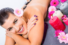 Beautiful woman enjoying a hot stone massage Royalty Free Stock Image