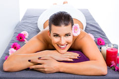 Beautiful woman enjoying a hot stone massage Stock Image