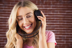 A beautiful woman enjoying listening her music Stock Photo