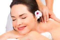 Beautiful woman enjoying a massage Stock Images