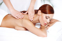 Beautiful woman enjoying a massage royalty free stock photography