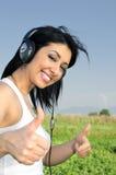 Beautiful woman Enjoying Music Stock Images