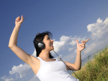 Beautiful woman enjoying music Stock Photo